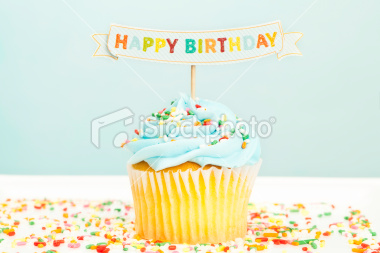 stock-photo-19091817-happy-birthday-cupcake