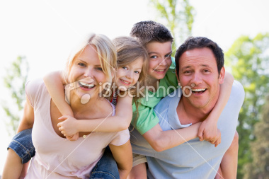 stock-photo-8235598-couple-giving-two-young-children-piggyback-rides