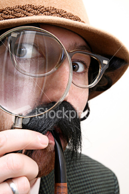 stock-photo-5845392-detective-inspector-with-mustache-pipe-amp-magnifying-glass